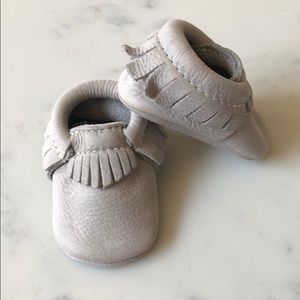 Gray pebbled freshly picked moccasins – size one